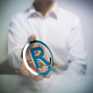 Особенности перехода исключительного права на товарный знак при реорганизации правообладателя